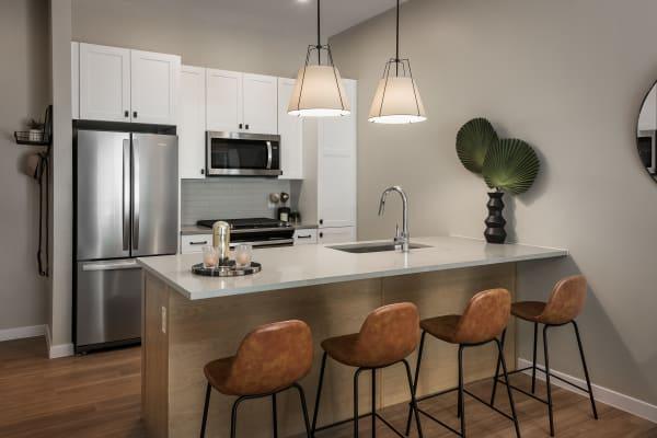 Modern kitchen with stainless steel appliances at Gramercy Scottsdale in Scottsdale, Arizona