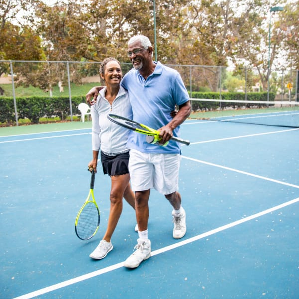 Residents playing tennis at Pacifica Senior Living Sterling in Sterling, Virginia