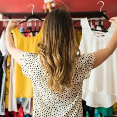 Resident shopping for clothes at Palmetto Greens Apartment Homes in Covington, Louisiana