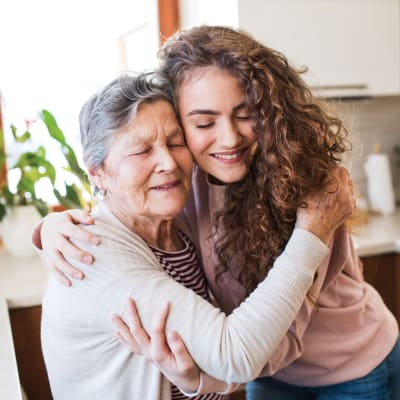 Resident hugging a younger person at a Ebenezer Senior Living community