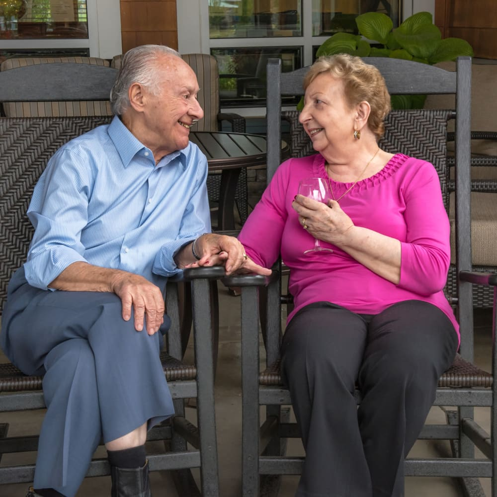 Two residents chatting on patio at The Springs at Greer Gardens in Eugene, Oregon