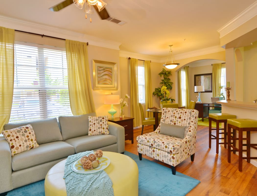 Interior model home living room with hardwood floors and ceiling fan at IMT Kingwood in Kingwood, Texas