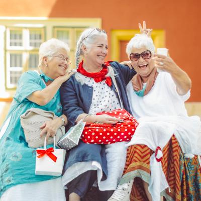 Smiling residents taking a selfie at Mountain View Retirement Village in Tucson, Arizona