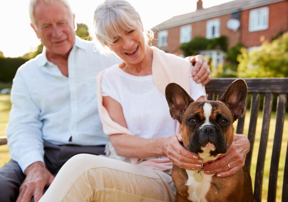 Residents sitting with dog near Kingston Bay Senior Living in Fresno, California.