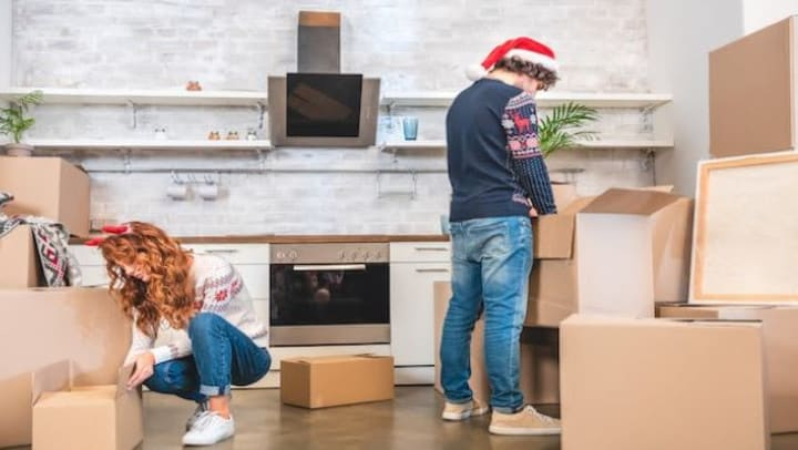 couple preparing for winter storage packing boxes