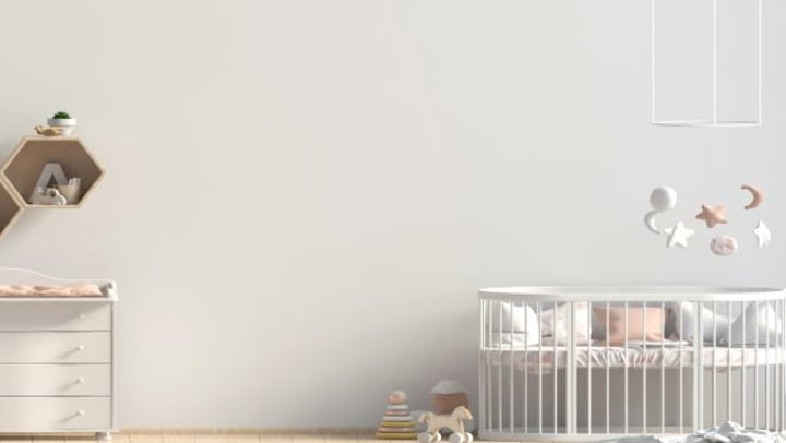 white room with items for nursery storage
