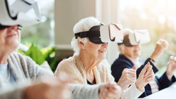 Seniors using VR at Living Care at Quail Park of Lynnwood in Lynnwood, Washington