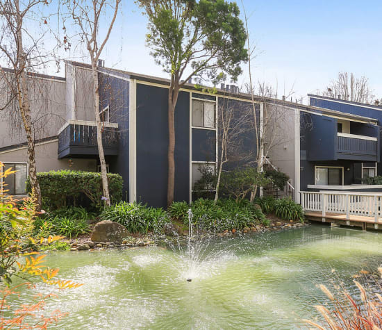 Pond with a water fountain at Tower Apartment Homes in Alameda, California