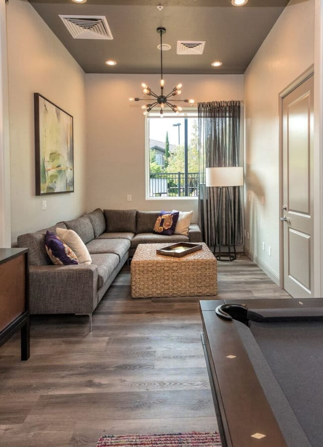 Clubhouse with a movie nook next to the pool table at The Artisan Apartment Homes in Sacramento, California