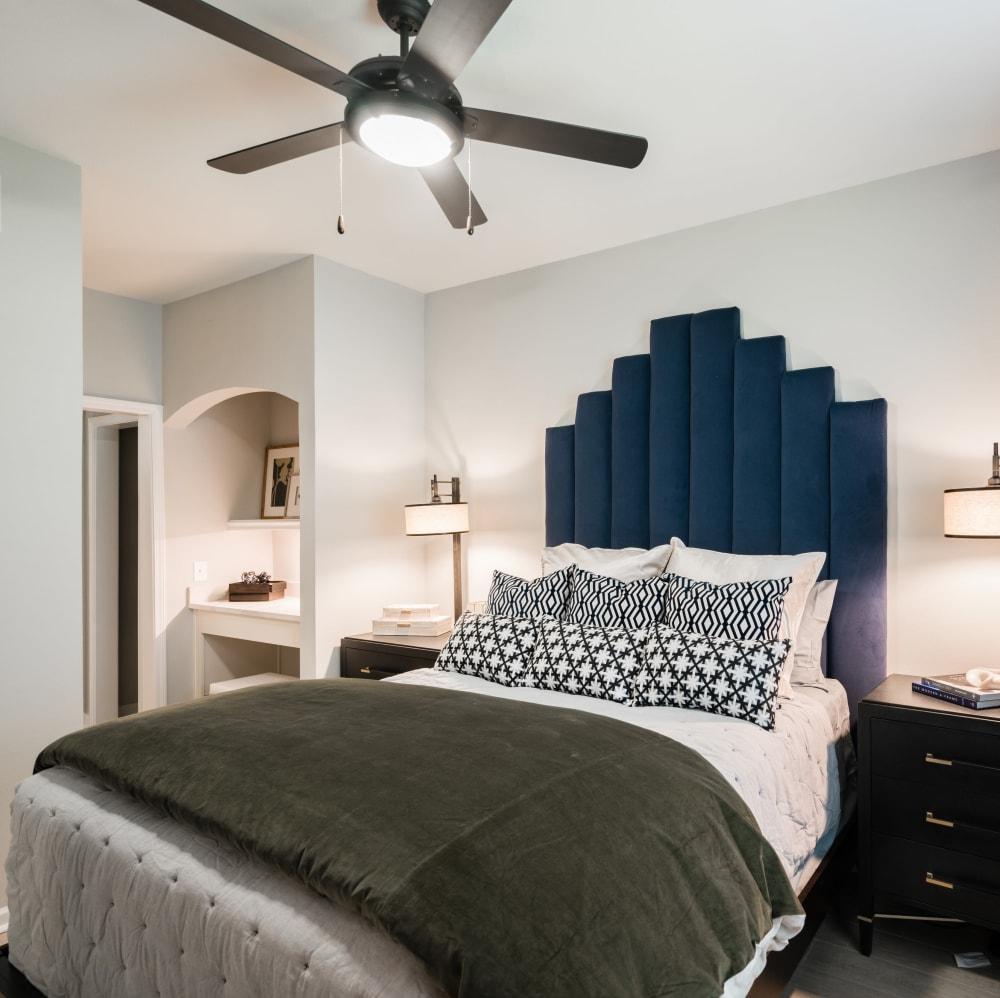Spacious master bedroom with a ceiling fan at The JaXon in Kingwood, Texas