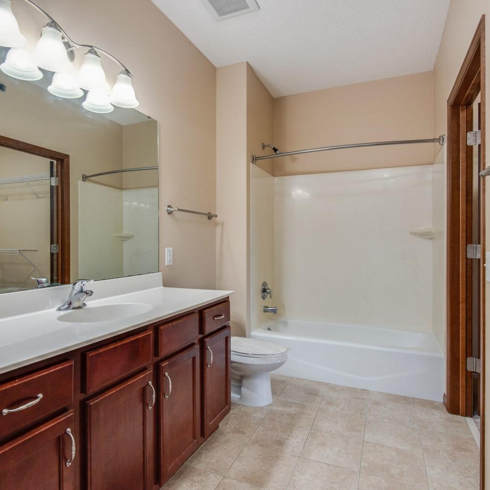 Large vanity mirror in a model apartment's bathroom at Oaks Glen Lake in Minnetonka, Minnesota