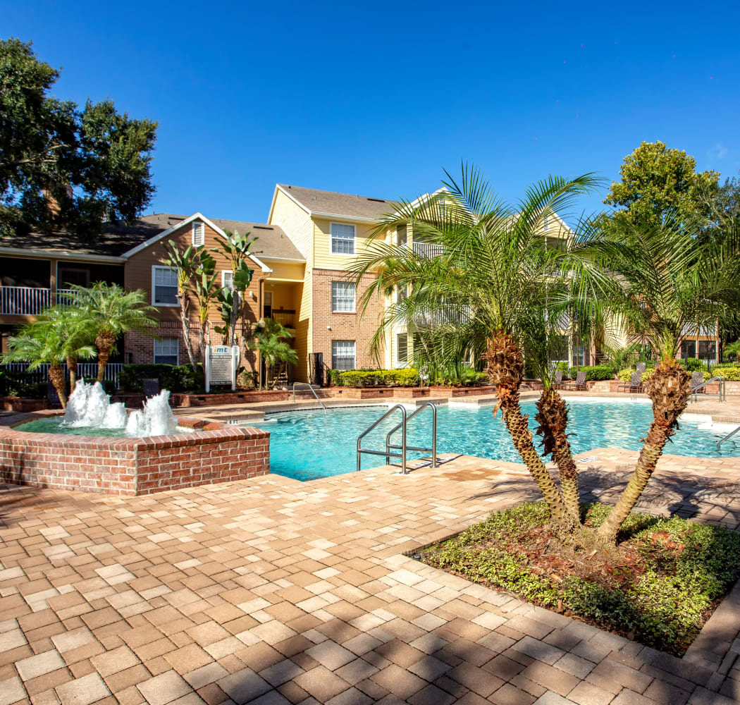 Swimming pool with fountain nearby at IMT Newport Colony in Casselberry, Florida