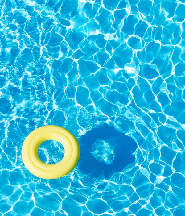 Beach ball floating in Park Village West's swimming pool in Westborough, Massachusetts