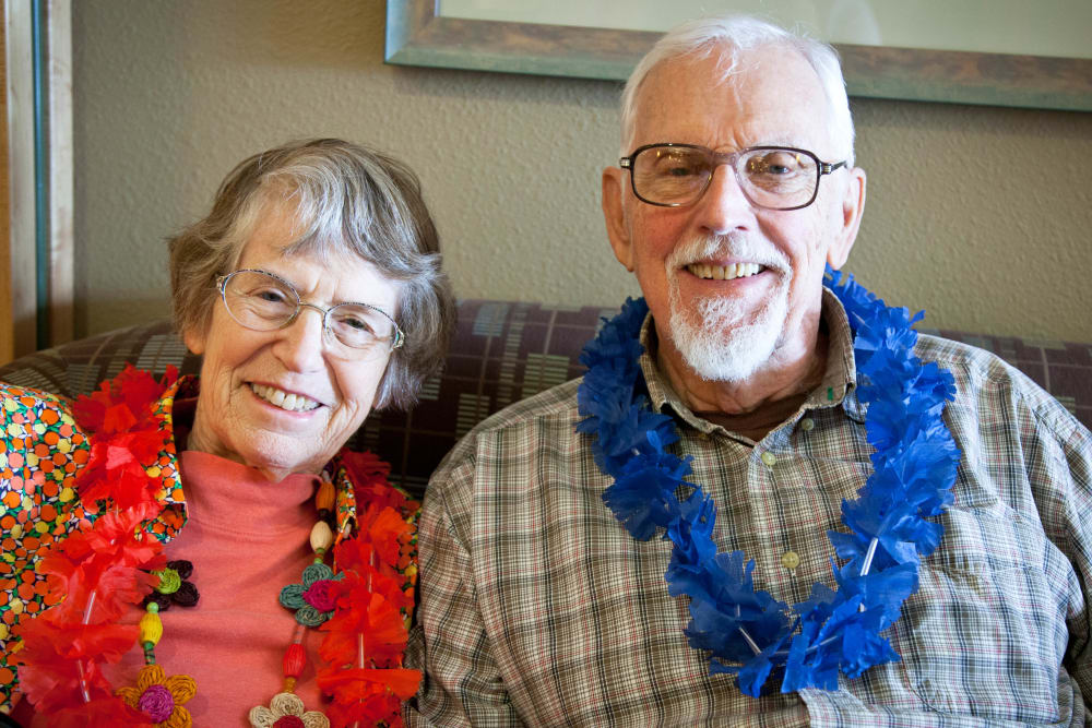 Couple enjoying a luau at Merrill Gardens at Bankers Hill, CA