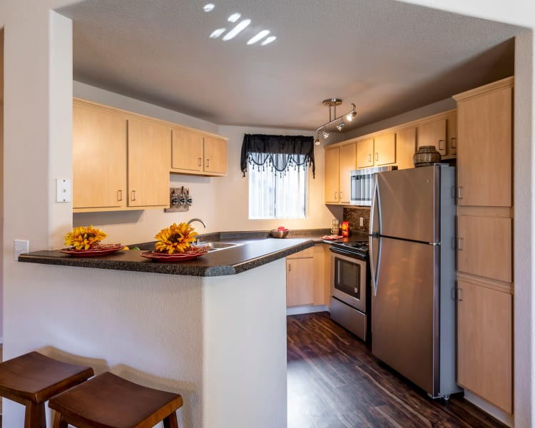 Kitchen features granite countertops at Broadstone Heights in Albuquerque, New Mexico
