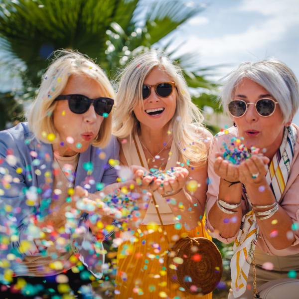 Women blowing confetti at Monte Vista Village in Lemon Grove, California