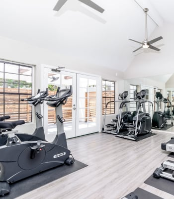 Fitness center with large windows at Sonora at Alta Loma in Alta Loma, California