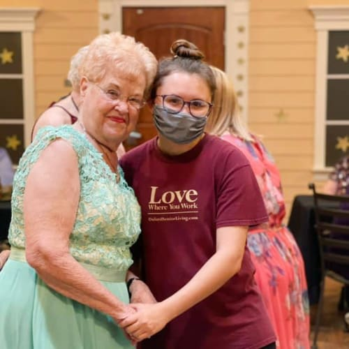 A team member interacting with a resident at Oxford Glen Memory Care at Owasso in Owasso, Oklahoma
