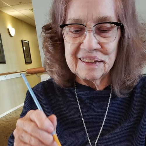 A resident at doing arts and crafts Canoe Brook Assisted Living & Memory Care in Catoosa, Oklahoma