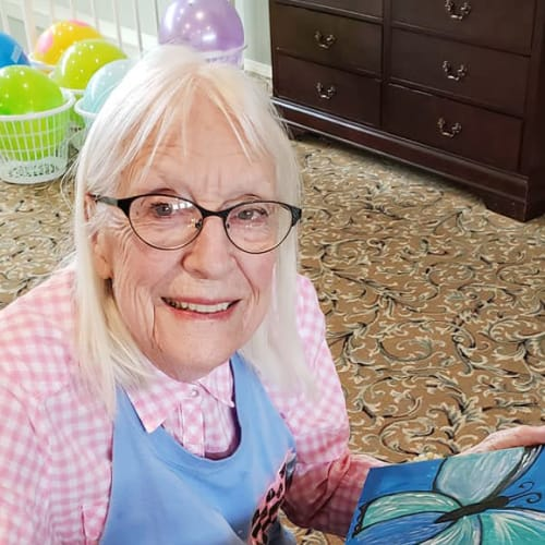 A resident painting at Canoe Brook Assisted Living & Memory Care in Catoosa, Oklahoma