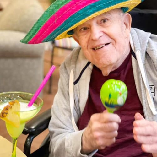 A Resident having a margarita at Oxford Glen Memory Care at Owasso in Owasso, Oklahoma