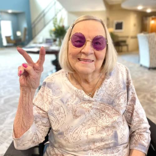 Resident peace sign at The Oxford Grand Assisted Living & Memory Care in McKinney, Texas