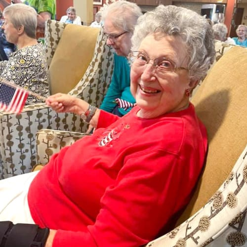 Resident smiling at The Oxford Grand Assisted Living & Memory Care in McKinney, Texas