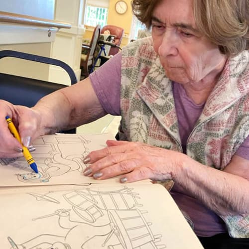 Resident coloring at Canoe Brook Assisted Living & Memory Care in Catoosa, Oklahoma