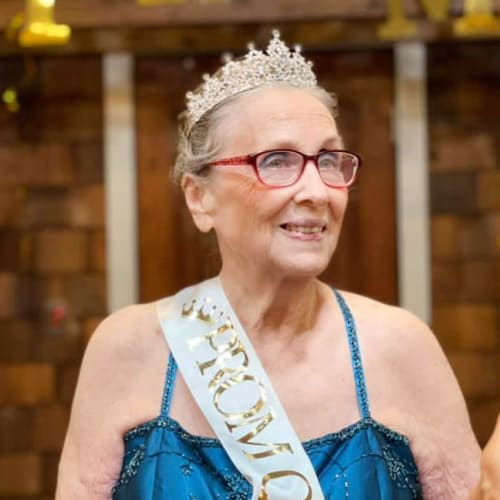 A resident as prom queen at Oxford Glen Memory Care at Owasso in Owasso, Oklahoma