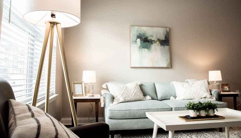 Well-decorated living area in a model home at Bonterra Apartments in Fort Wayne, Indiana