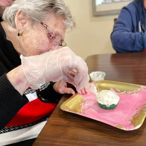 Resident making cupcakes at The Oxford Grand Assisted Living & Memory Care in McKinney, Texas
