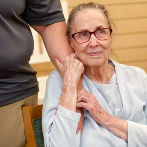 Resident holding caretaker at Oxford Glen Memory Care at Owasso in Owasso, Oklahoma
