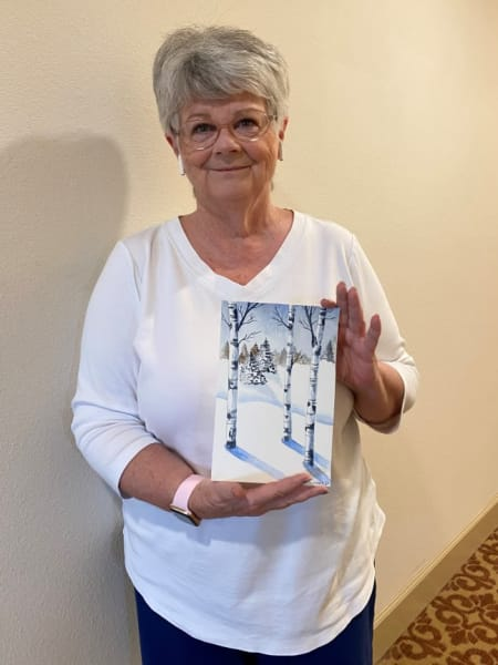 The woman who painted the tree painting