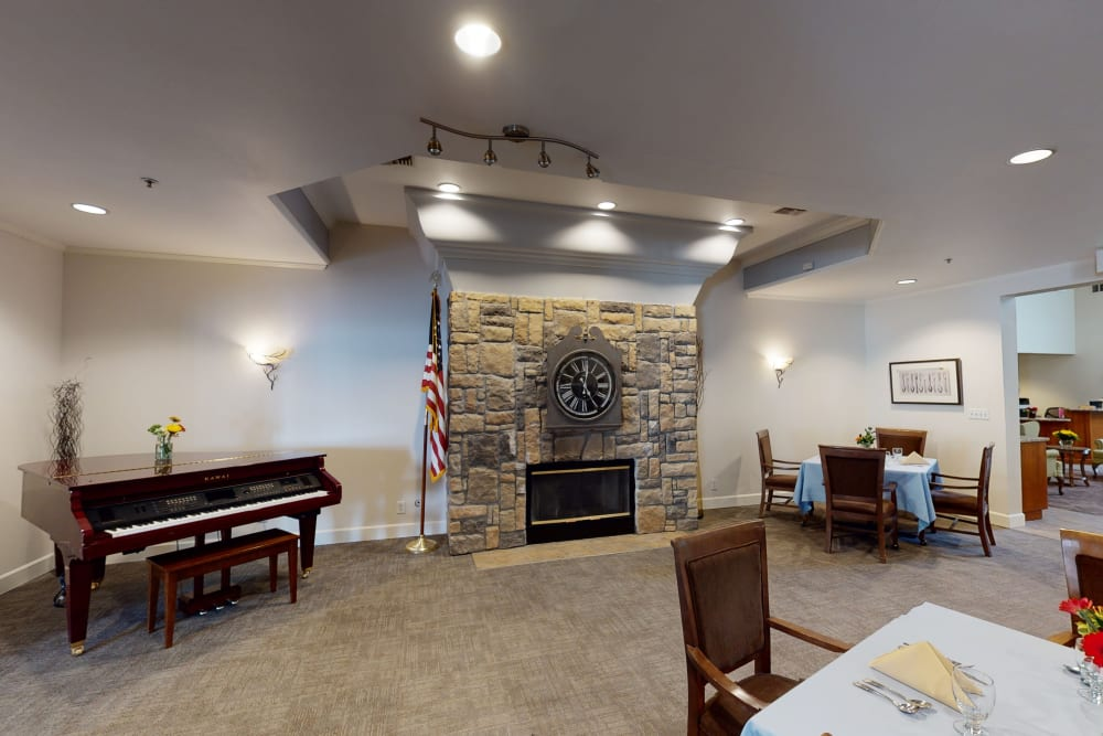 Peters Creek Retirement & Assisted Living fireplace seating with piano