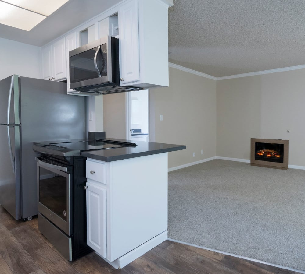 Kitchen with a pass through window at Valley Ridge Apartment Homes in Martinez, California