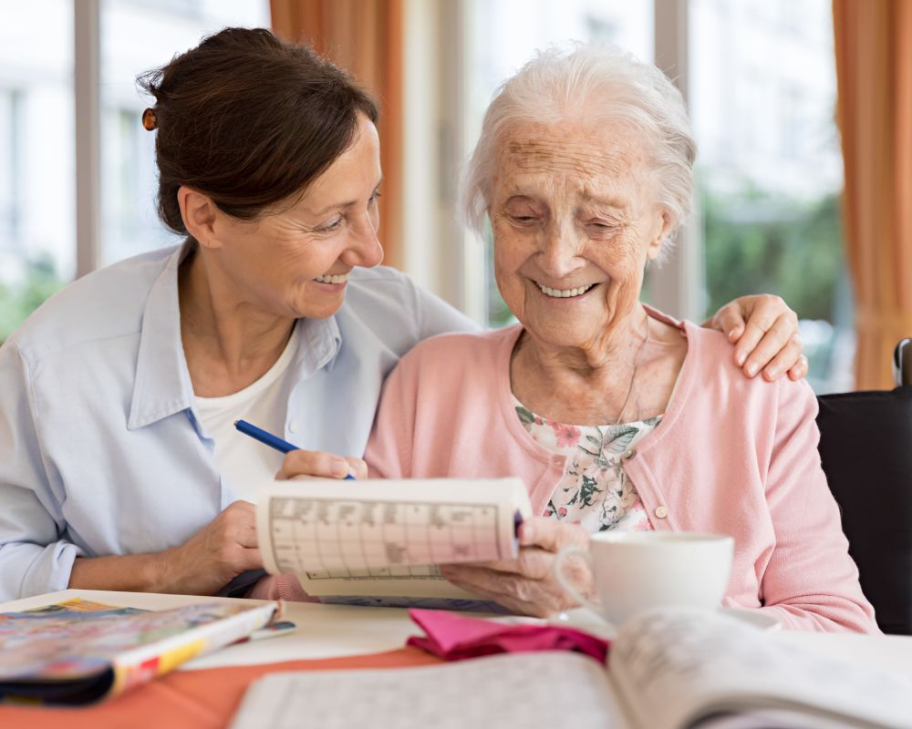 Nurse assisting senior at Seven Lakes Memory Care in Loveland, Colorado