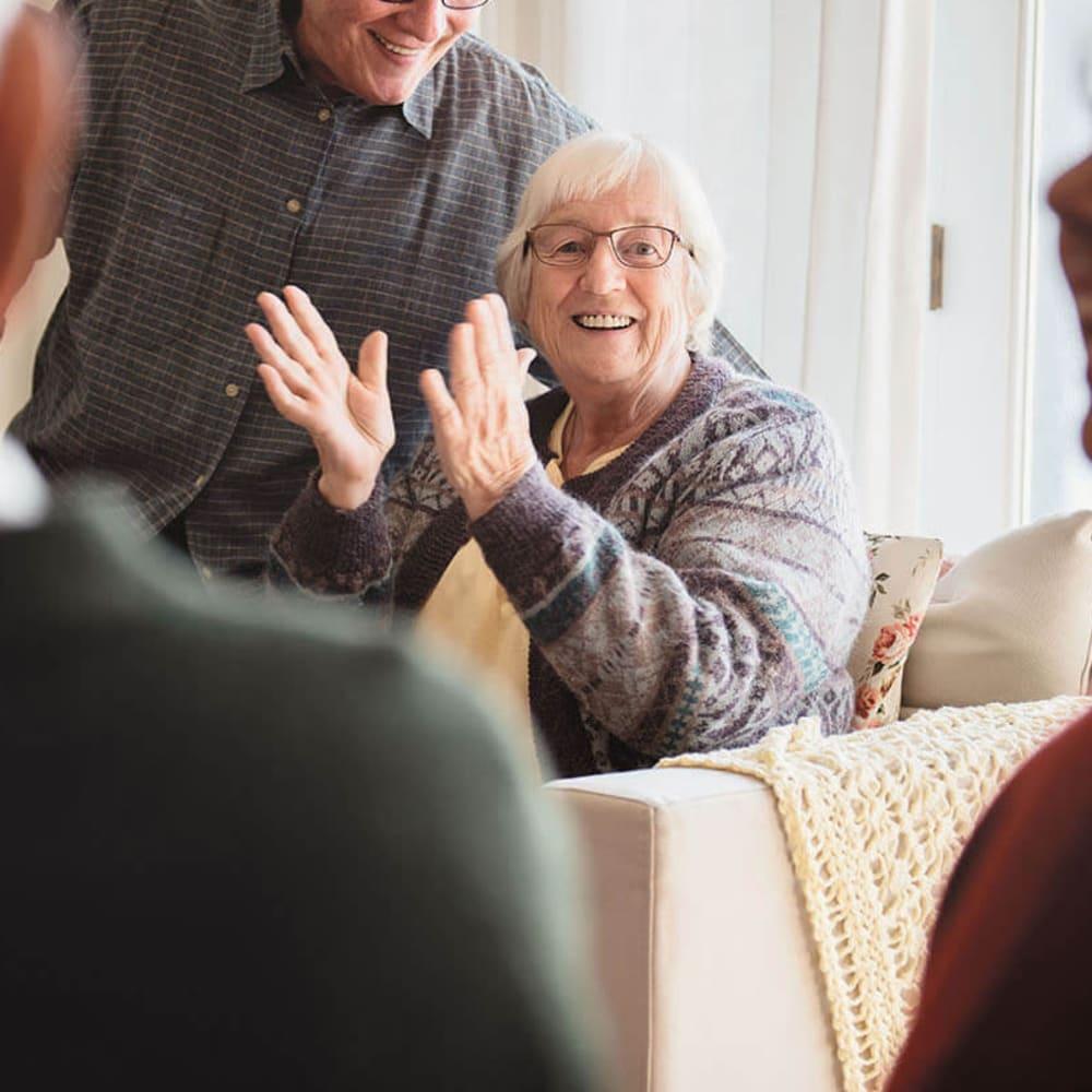 Happy resident clapping at Anthology of South Jordan in South Jordan, Utah