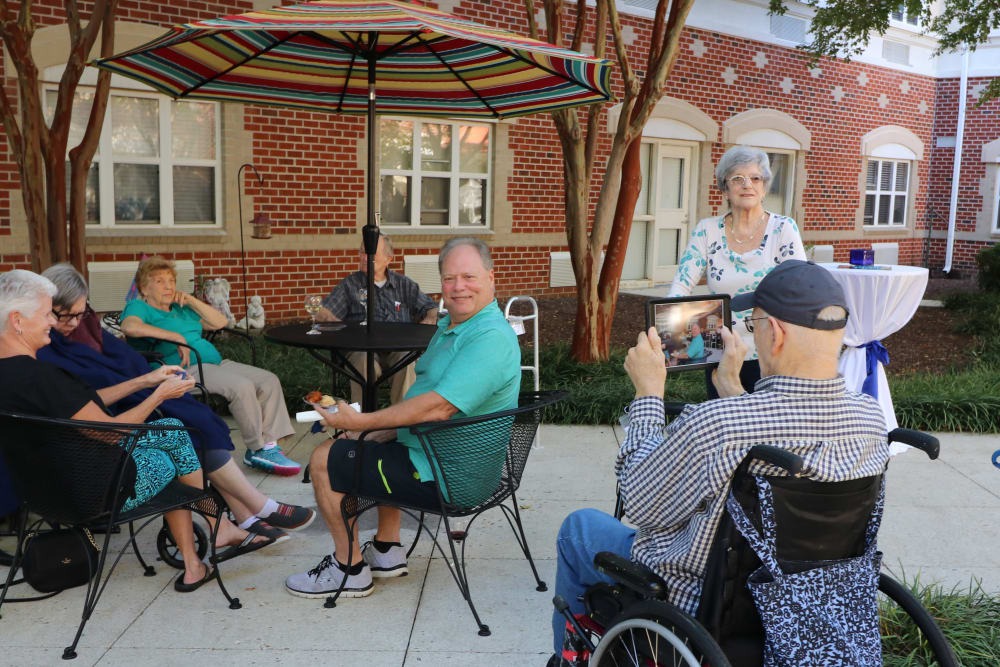 Residents enjoying the courtyard at Harmony at Ironbridge in Chester, Virginia