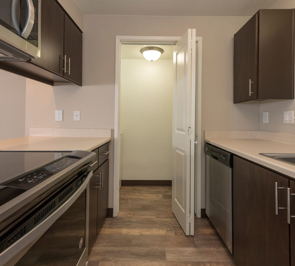 Kitchen with a pantry space at Slate Ridge at Fisher's Landing Apartment Homes in Vancouver, Washington