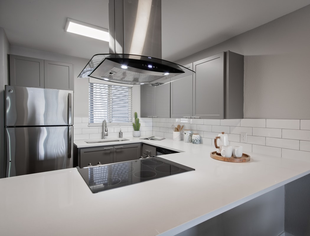 Ultramodern kitchen with stainless-steel appliances and subway tile backsplash in model home at MiLO at Mountain Park