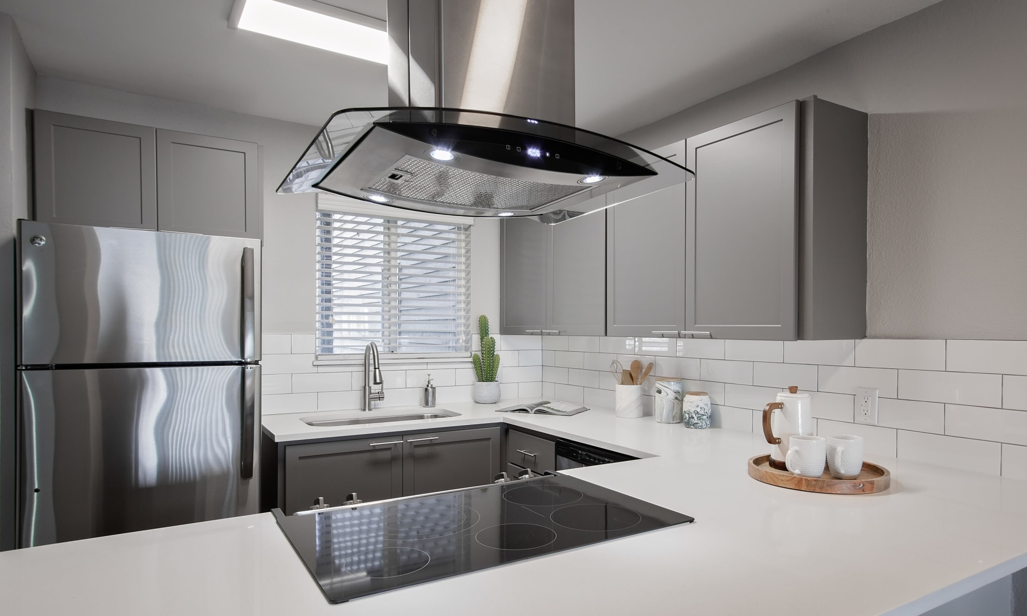 Beautiful modern kitchen in model home at MiLO at Mountain Park