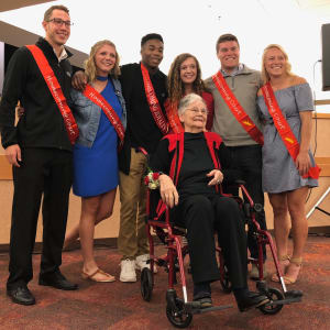 Resident Jo with Homecoming Court at Edencrest at The Legacy in Norwalk, Iowa.