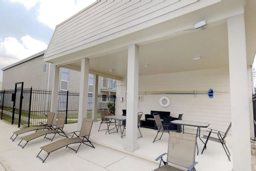Covered outdoor lounge by the pool at Northlake Manor Apartments in Humble, TX
