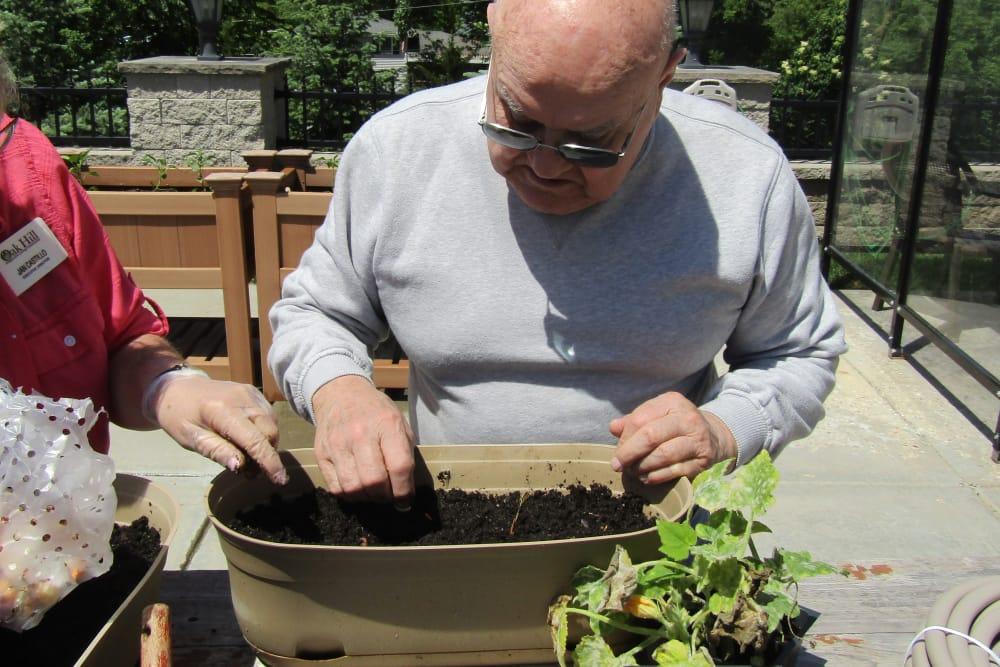 senior resident planting in the garden