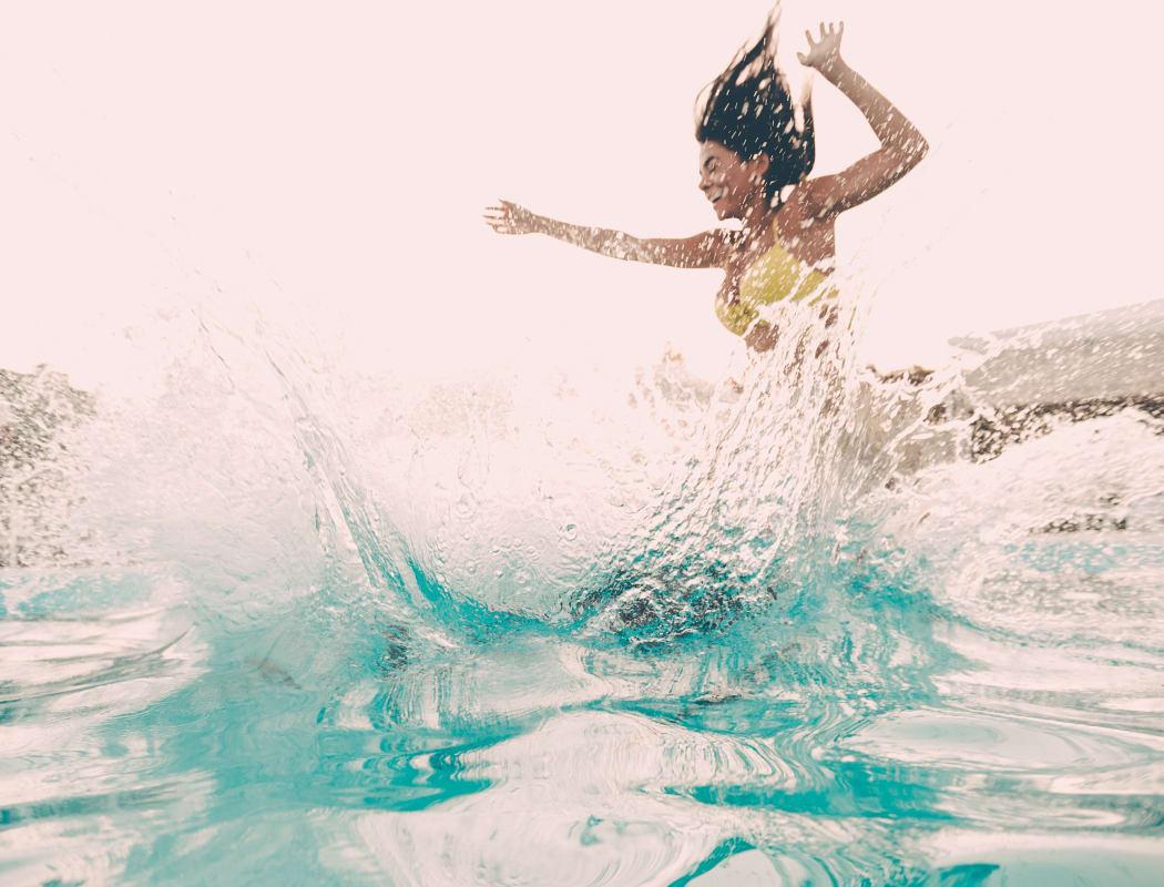Girl jumping into the pool at Tammaron Village Apartments in Oklahoma City, Oklahoma