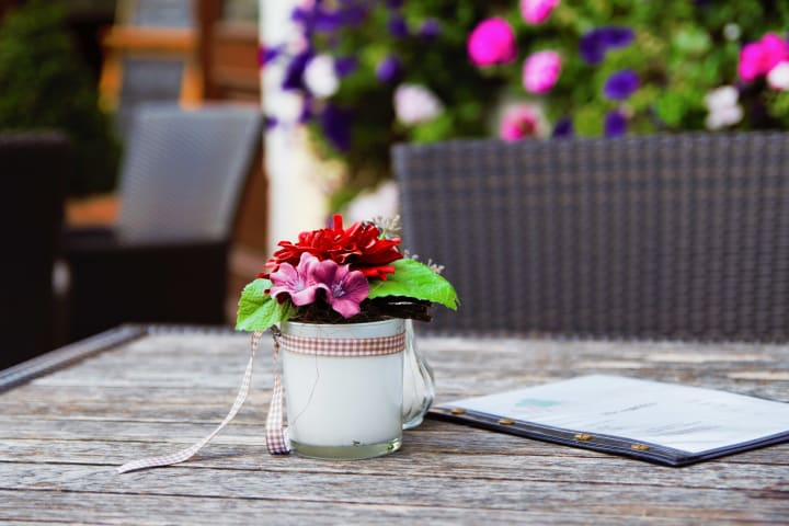 Flowers on a patio at {{location_name}}