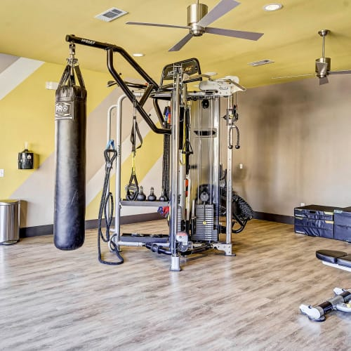 Heavy bag and exercise machines in the onsite fitness center at Sundance Creek in Midland, Texas