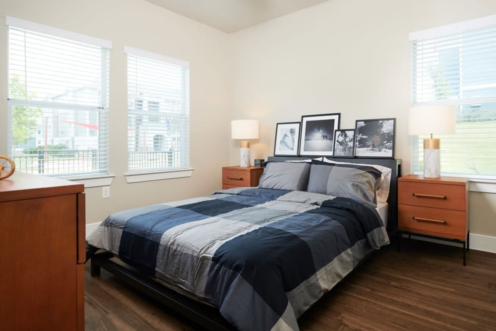 Bedroom with hardwood floors at Parallax @ Georgetown in Georgetown, Texas
