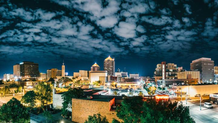 The lit-up Albuquerque skyline at night.