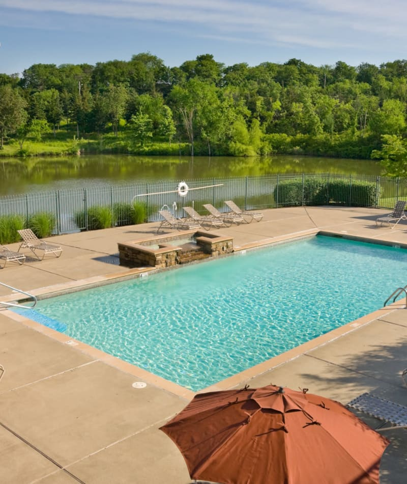 Saltwater swimming pool area overlooking the nearby lake at Timber Lakes Apartment Homes in Kansas City, Missouri
